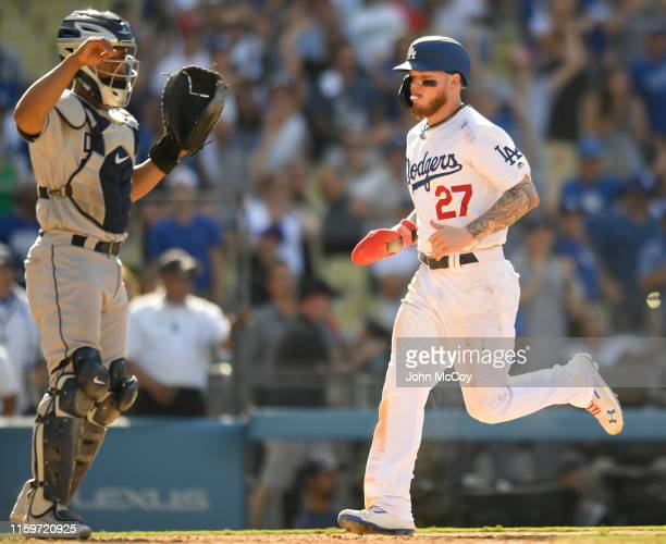 Alex Verdugo of the Los Angeles Dodgers runs past Francisco Mejia of the San Diego Padres after being driven in by Max Muncy in the ninth inning at...