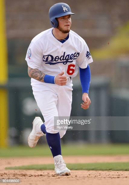 Alex Verdugo of the Los Angeles Dodgers runs the bases during the game against the Chicago White Sox on February 23 2018 at Camelback Ranch in...