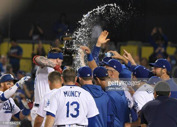 Alex Verdugo of the Los Angeles Dodgers runs to home plate to celebrate his 11th inning walkoff home run defeated the Colorado Rockies 54 at Dodger...
