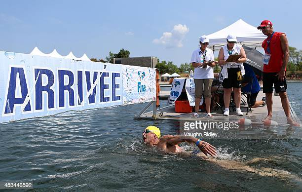 Alex Verra of France competes in the Men's 5054 Age Group 3km swim during the 15th FINA World Masters Championships at Parc JeanDrapeau on August 10...