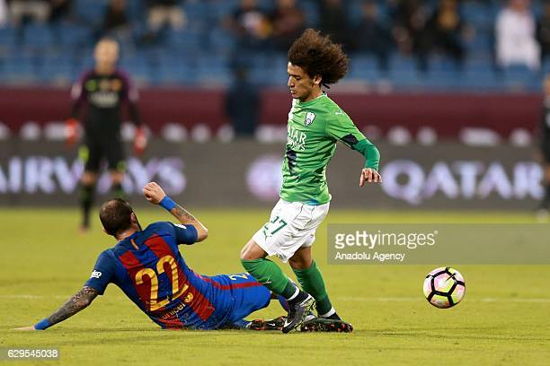 Alex Vidal of Barcelona in action against Omar Abdulrahman during a friendly soccer match between Al-Ahli Saudi and Barcelona at Al-Gharrafa Stadium...