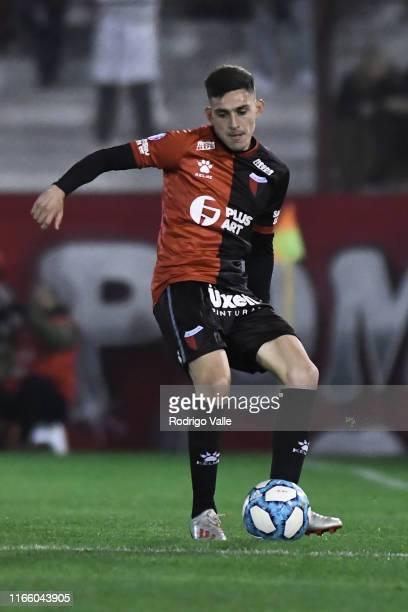 Alex Vigo of Colon drives the ball during a match between Huracán and Colón as part of Superliga Argentina 2019/20 at Tomas Adolfo Duco Stadium on...