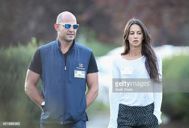 Alex Von Furstenberg chief investment officer for Arrow Capital Management LLP walks with Ali Kay at the Allen Company Sun Valley Conference on July...