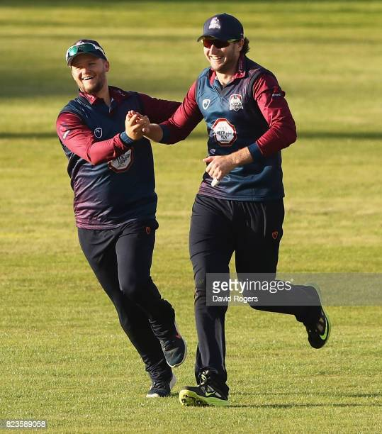 Alex Wakely of Northamptonshire celebrates with team mate Ben Duckett after catching Ross Whiteley during the NatWest T20 Blast match between...