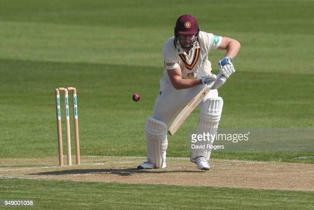 Alex Wakely of Northamptonshire drives the ball during the Specsavers County Championship division two match between Northamptonshire and...