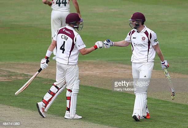 Alex Wakely of Northants celebrates his fifty with Josh Cobb of Northants during the LV County Championship division two match between...