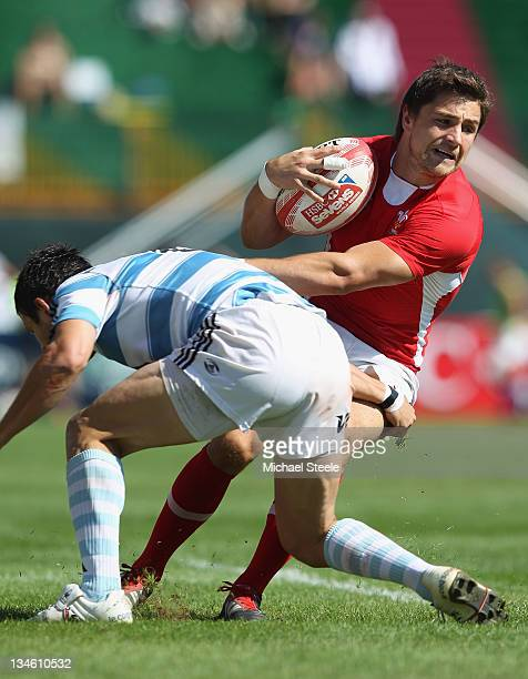 Alex Walker of Wales is held up by Gonzalo Gutierrez Taboada of Argentina during the Quarter Final match between Argentina and Wales during Day Three...