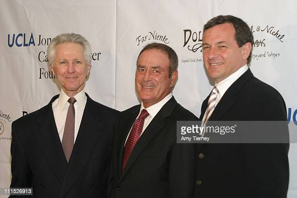 Alex Wallau President of ABC Network Operations and Administration Al Michaels and Robert Iger President CEO The Walt Disney Company