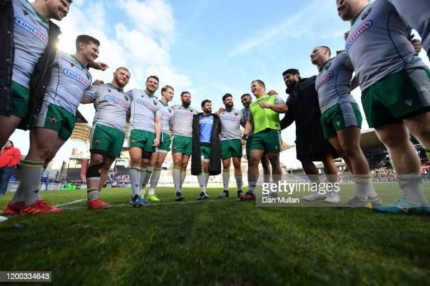 Alex Waller of Northampton Saints speaks to his players in a huddle following their victory during the Heineken Champions Cup Round 6 match between...