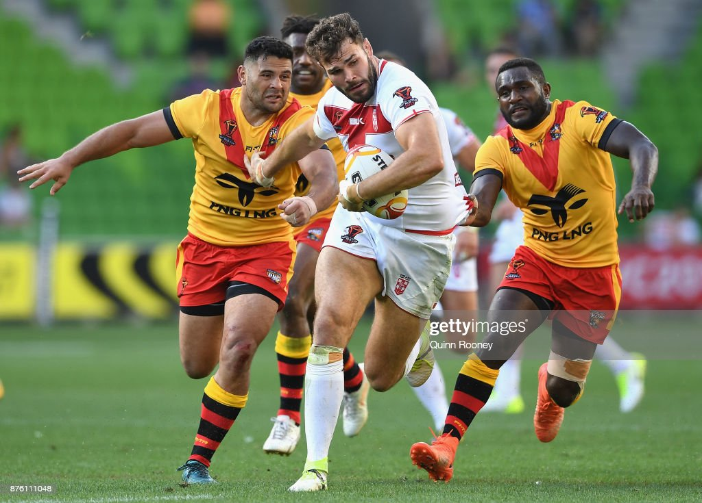Alex Walmsley of England breaks through a tackle during the 2017 Rugby League World Cup Quarter Final match between England and Papua New Guinea Kumuls at AAMI Park on November 19, 2017 in Melbourne, Australia.