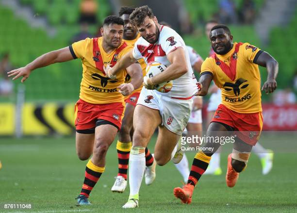 Alex Walmsley of England breaks through a tackle during the 2017 Rugby League World Cup Quarter Final match between England and Papua New Guinea...
