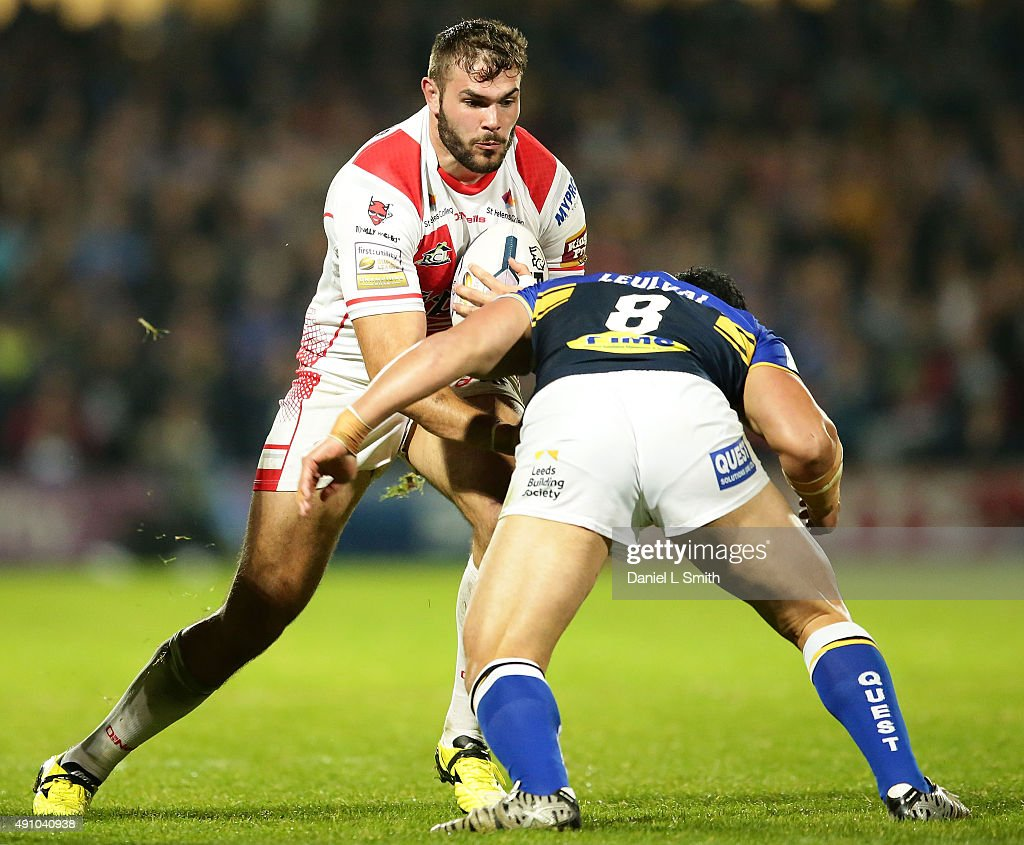 Alex Walmsley of St. Helens R.F.C in possession is tackled by Kylie Leuluai of Leeds Rhinos during the First Utility Super League Semi Final between Leeds Rhinos and St Helens at Headingley Carnegie Stadium on October 2, 2015 in Leeds, England.