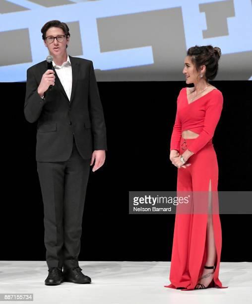 Alex Walton speaks onstage ahead of the Opening Night Gala screening of Hostiles as Q'Orianka Kilcher looks on during the 14th annual Dubai...