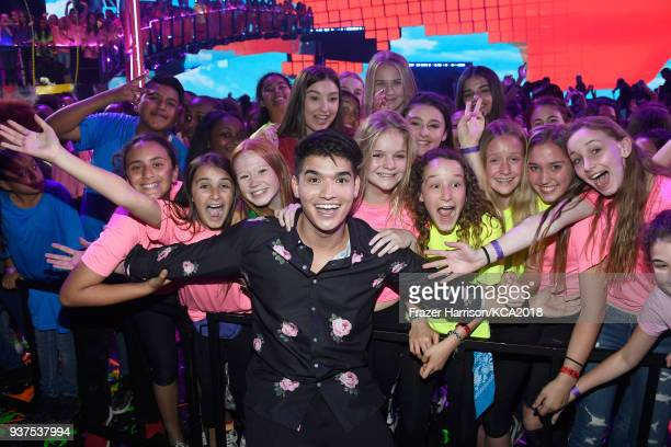 Alex Wassabi poses with fans during Nickelodeon's 2018 Kids' Choice Awards at The Forum on March 24 2018 in Inglewood California