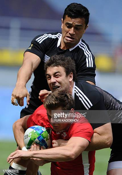 Alex Webber of Wales vies with Kurt Baker and Sherwin Stowers of NewZealand during their quarter final match at the 2013 Rugby World Cup Sevens in...