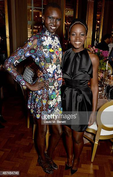 Alex Wek and Lupita Nyong'o attend the Sindika Dokolo Art Foundation dinner at Cafe Royal on October 18 2014 in London England