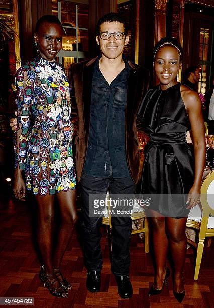 Alex Wek Sindika Dokolo and Lupita Nyong'o attend the Sindika Dokolo Art Foundation dinner at Cafe Royal on October 18 2014 in London England