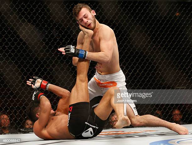 Alex White kicks Clay Collard in their bantamweight bout during the UFC 181 event inside the Mandalay Bay Events Center on December 6, 2014 in Las...