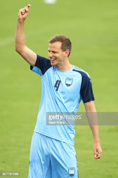 Alex Wilkinson laughs as he gestures to a team mate during a warmup drill at a Sydney FC ACL training session at Macquarie Uni on March 6 2018 in...