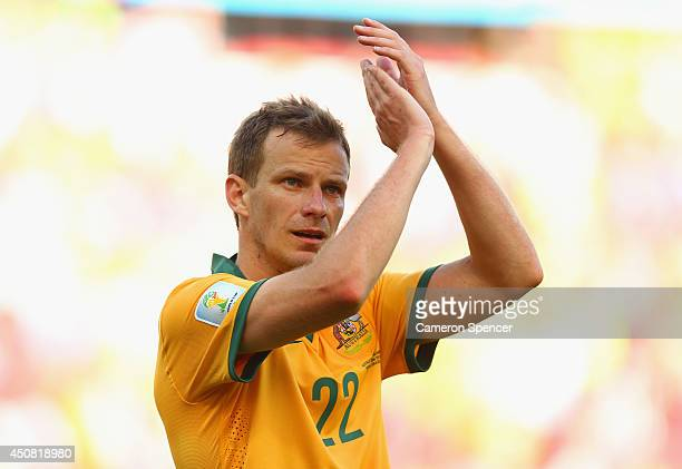 Alex Wilkinson of Australia acknowledges the fans after a 32 defeat in the 2014 FIFA World Cup Brazil Group B match between Australia and Netherlands...