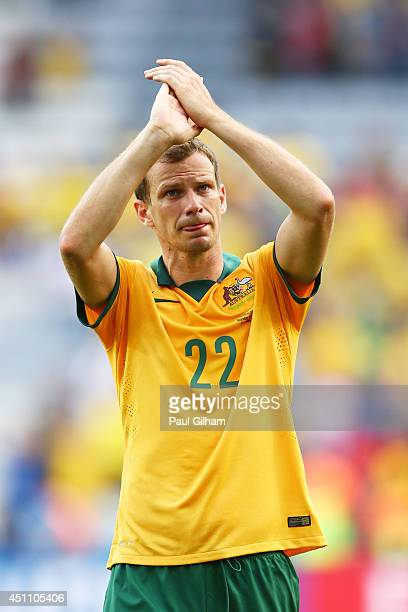 Alex Wilkinson of Australia acknowledges the fans after being defeated by Spain 30 during the 2014 FIFA World Cup Brazil Group B match between...