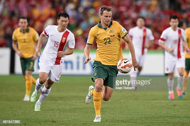 Alex Wilkinson of Australia competes for the ball during the 2015 Asian Cup match between China PR and the Australian Socceroos at Suncorp Stadium on...