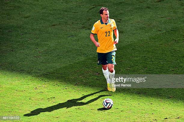 Alex Wilkinson of Australia controls the ball during the 2014 FIFA World Cup Brazil Group B match between Australia and Spain at Arena da Baixada on...
