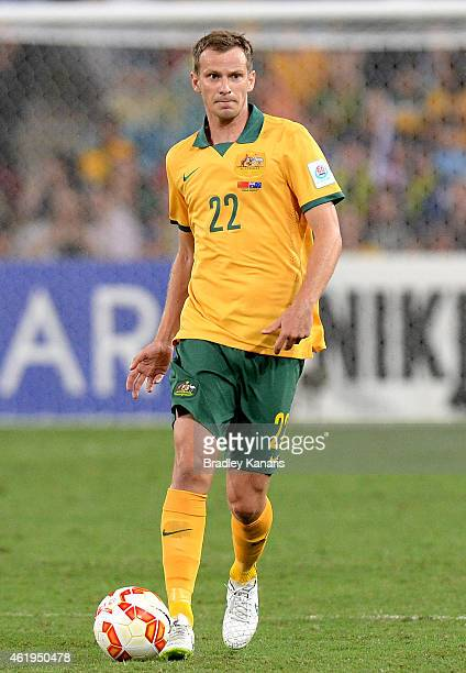 Alex Wilkinson of Australia looks to pass during the 2015 Asian Cup match between China PR and the Australian Socceroos at Suncorp Stadium on January...