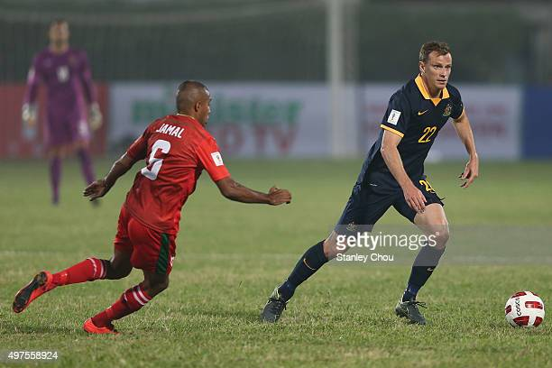 Alex Wilkinson of Australia Socceroos is chase by Jamal of Bangladesh during the 2018 FIFA World Cup Qualification match between Bangladesh and the...