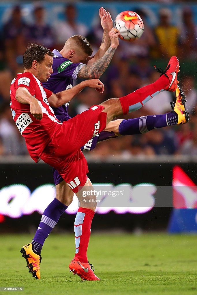 Alex Wilkinson of Melbourne and Andy Keogh of the Glory contest for the ball during the round 26 A-League match between the Perth Glory and Melbourne City FC at nib Stadium on April 3, 2016 in Perth, Australia.