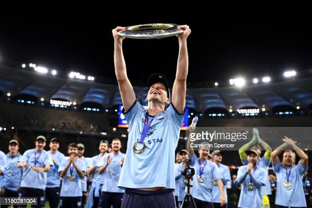 Alex Wilkinson of Sydney FC celebrates with the trophy after winning the 2019 A-League Grand Final match between the Perth Glory and Sydney FC at...