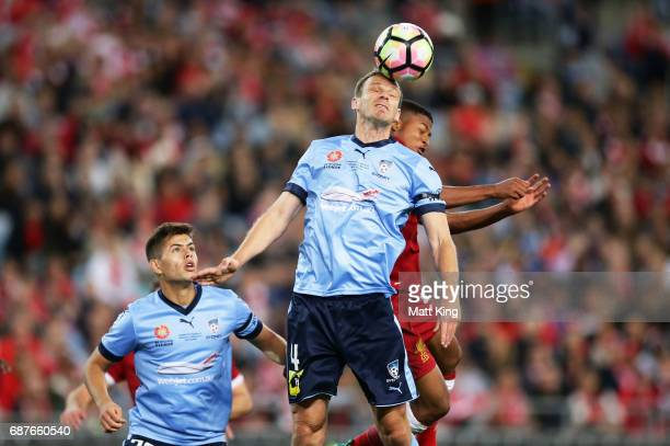 Alex Wilkinson of Sydney FC heads the ball in front of Rhian Brewster of Liverpool during the International Friendly match between Sydney FC and...