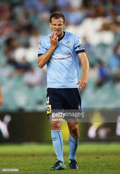 Alex Wilkinson of Sydney FC holds his teeth after a clash during the round 19 ALeague match between Sydney FC and the Wellington Phoenix at Allianz...