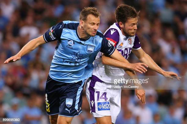 Alex Wilkinson of Sydney is challenged by Chris Harold of the Glory during the round 13 ALeague match between Sydney FC and Perth Glory at Allianz...