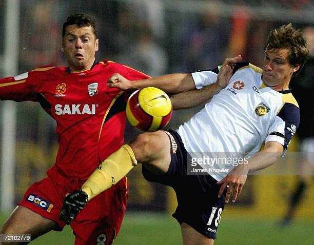 Alex Wilkinson of the Mariners and Carl Veart of United heads fight for the ball during the round seven Hyundai A-League match between Adelaide...
