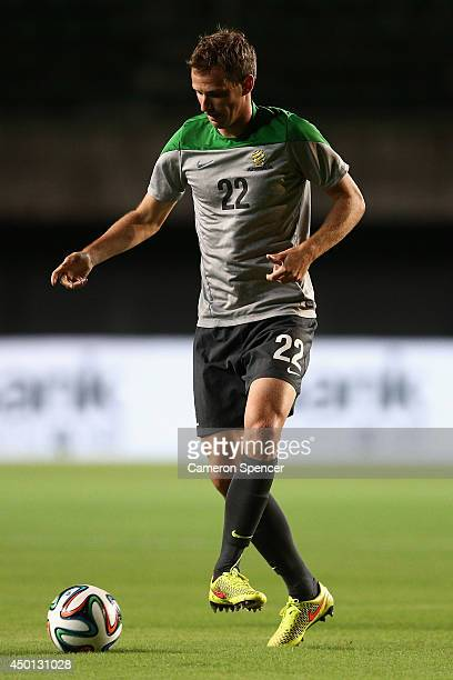 Alex Wilkinson of the Socceroos passes the ball during an Australian Socceroos training session at Pituacu Stadium on June 5 2014 in Salvador Brazil...