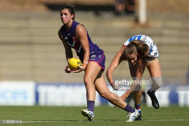Alex Williams of the Dockers looks to handball during the round five AFLW match between the Fremantle Dockers and the Western Bulldogs at Fremantle...
