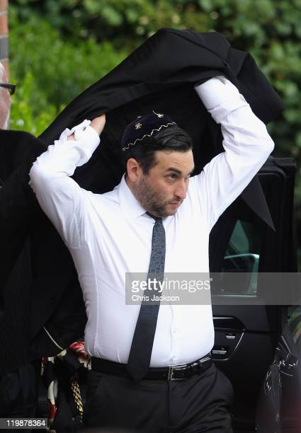 Alex Winehouse arrives for the cremation of Amy Winehouse at Golders Green Crematorium on July 26 2011 in London England Winehouse was found dead in...