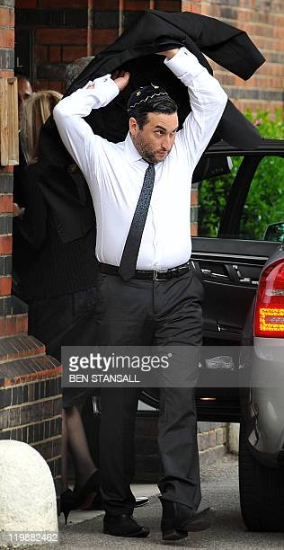 Alex Winehouse brother of late British singer Amy Winehouse arrives for a cremation ceremony for his sister in north London on July 26 2011 Amy...