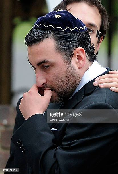 Alex Winehouse brother of late British singer Amy Winehouse is comforted by friends and relatives as he attends a cremation ceremony for his sister...