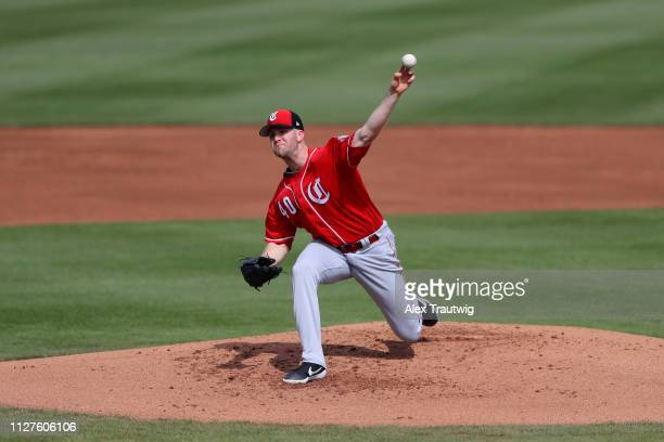 Alex Wood of the Cincinnati Reds pitches during a Spring Training game against and the Seattle Mariners on Monday February 25 2019 at Peoria Sports...