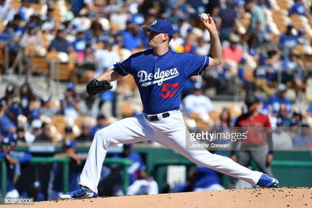 Alex Wood of the Los Angeles Dodgers delivers a pitch in the first inning of the spring training game against the Arizona Diamondbacks at Camelback...