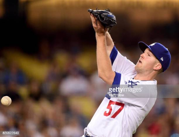 Alex Wood of the Los Angeles Dodgers drops a pop fly hit by Jaime Garcia of the Atlanta Braves allowing two runs to score to trail the Braves 40...