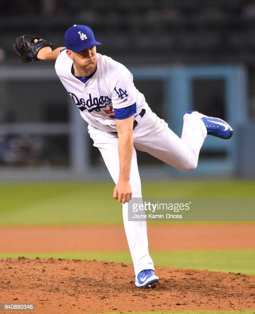 Alex Wood of the Los Angeles Dodgers pitches in the third inning of the game against the San Francisco Giants at Dodger Stadium on March 30 2018 in...