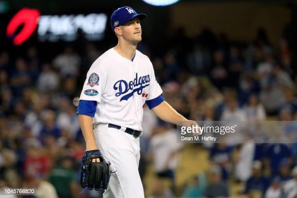 Alex Wood of the Los Angeles Dodgers reacts after being removed from the game during the ninth inning against the Atlanta Braves during Game One of...