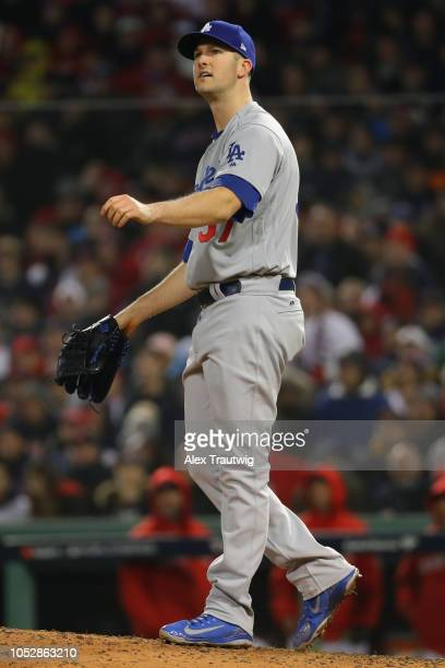 Alex Wood of the Los Angeles Dodgers reacts after giving up a three run home run to Eduardo Nunez of the Boston Red Sox in the seventh inning during...