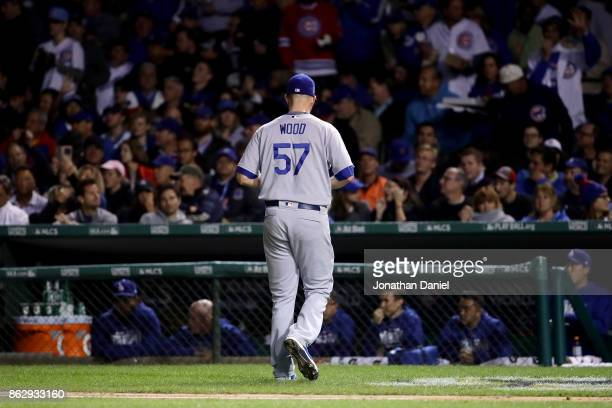 Alex Wood of the Los Angeles Dodgers walks off the field after being relieved in the fifth inning against the Chicago Cubs during game four of the...