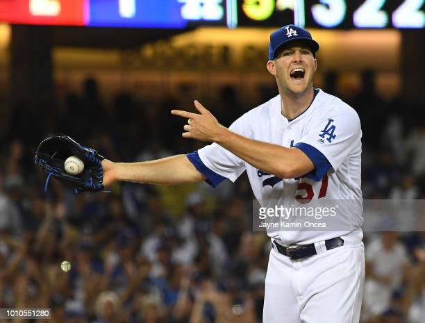 Alex Wood of the Los Angeles Dodgers yells at the umpire after the Houston Astros bench yelled out that he balked in the sixth inning at Dodger...