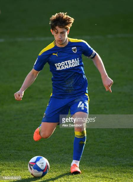 Alex Woodyard of AFC Wimbledon runs with the ball during the Sky Bet League One match between AFC Wimbledon and Hull City at Plough Lane on February...