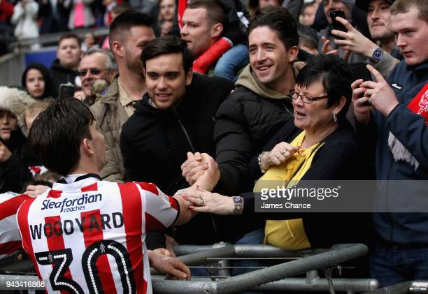 Alex Woodyard of Lincoln City celebrates with fans after the Checkatrade Trophy Final match between Shrewsbury Town and Lincoln City at Wembley...